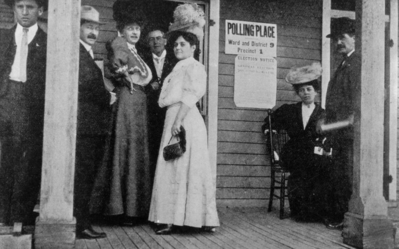 A historical image of a woman's first time voting.