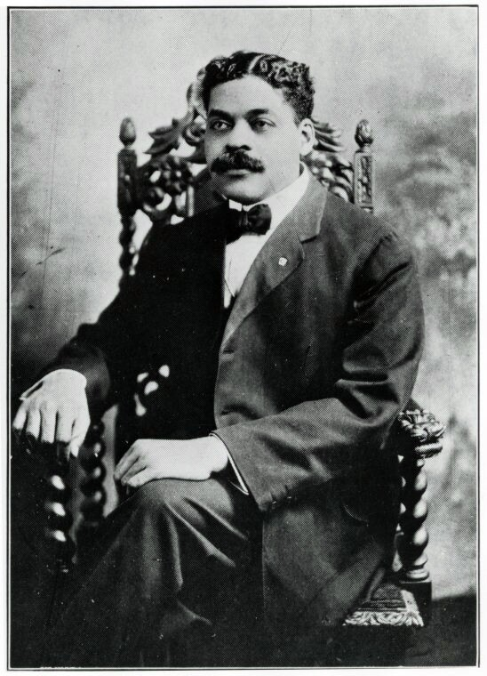 Man with a mustache wearing a suit
